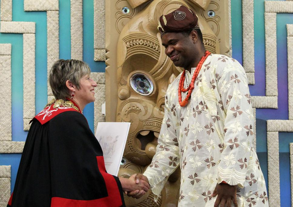 SHAKE ON THAT: NZ new citizens ceremony on Waitangi Day at the Rapaki Marae.  Mayor Lianne Dalziel  with Christian Ogbah from Nigeria.