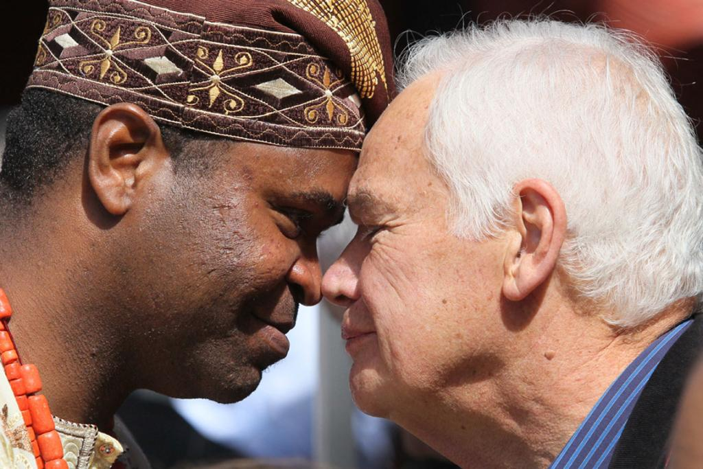 HONGI: NZ new citizens ceremony on Waitangi Day at the Rapaki Marae Christian Ogbah from Nigeria in a hongi with Donald Couch of Ngai Tahu.