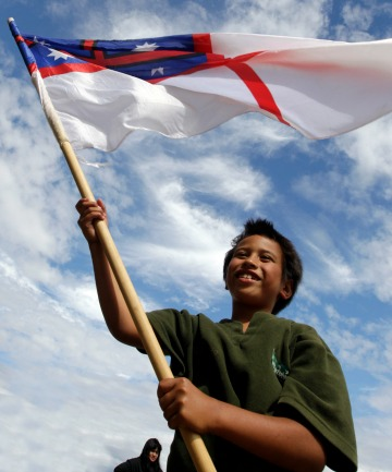ALL ABOUT WHANAU: TK Tamiti-Campbell, 7, with the United Tribes flag, enjoys celebrations at The Point, Ngaruawahia.