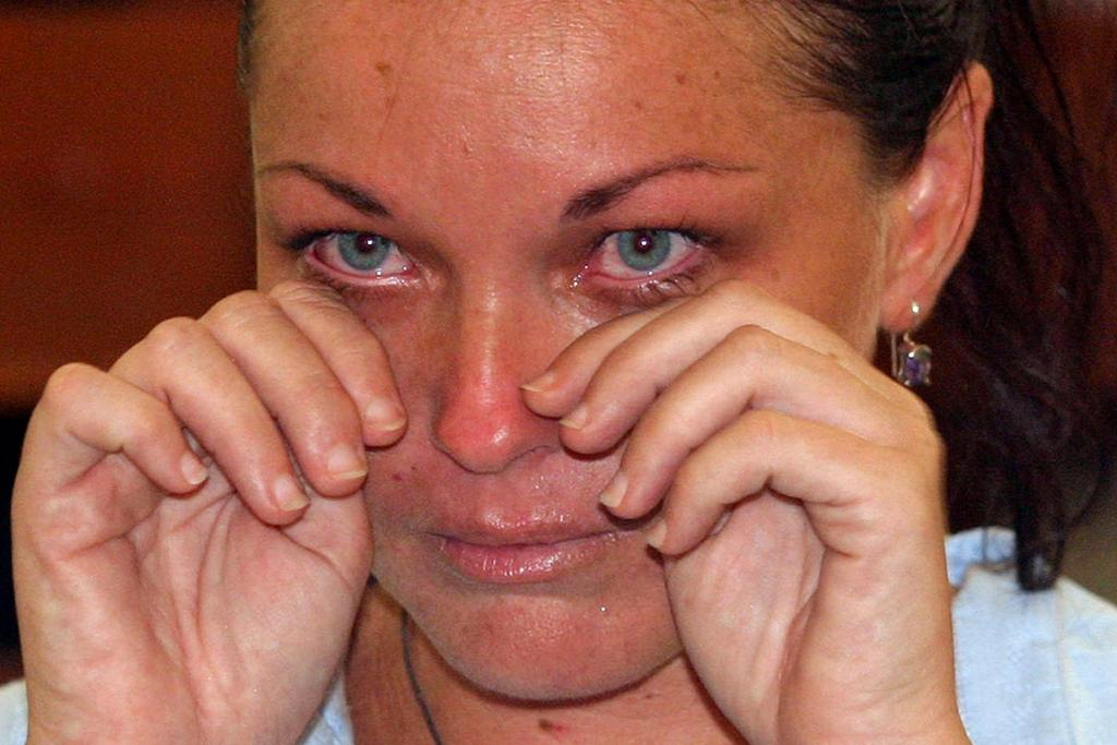 Schapelle Leigh Corby, a then-27-year-old Australian, cries as she sits in a courtroom during her trial for drug smuggling in Denpasar on January 27, 2005.