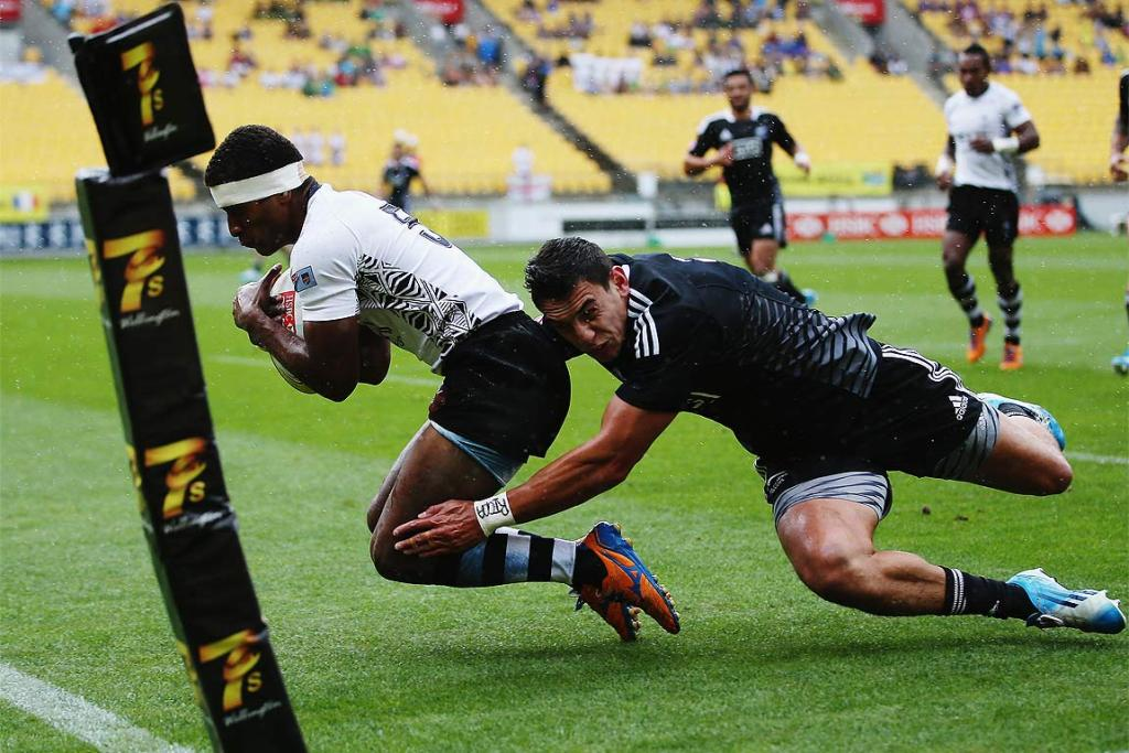 Emosi Mulevoro of Fiji dives over to score a try against New Zealand.