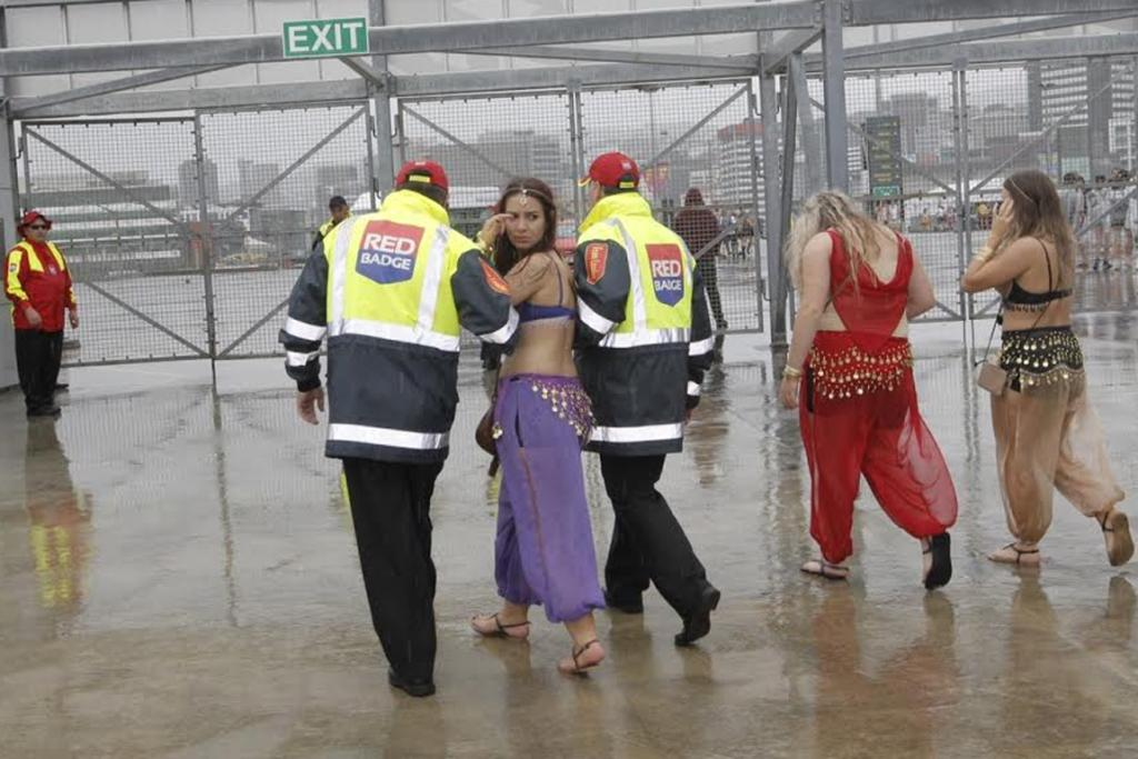A belly dancer is escorted out of Westpac Stadium.