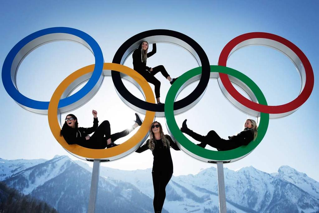 Snowboarders Shelly Gotlieb, Stefi Luxton, Christy Prior and Rebecca Torr pose in the Olympic rings in the athletes village.