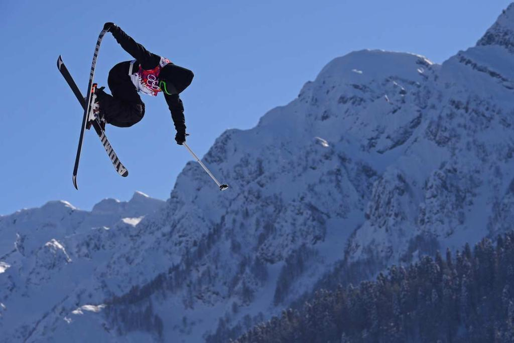 With the mountains as a back-drop, Jossi Wells practises for the men's ski slopestyle.
