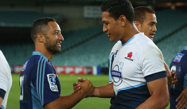 Former rugby league stars Benji Marshall and Israel Folau share a moment after Friday night's Super Rugby pre-season match in Sydney.