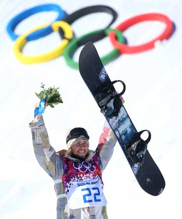 GOLDEN GUY: American Sage Kotsenburg celebrates winning the first medal of the Sochi Games, claiming the men's snowboard slopestyle.
