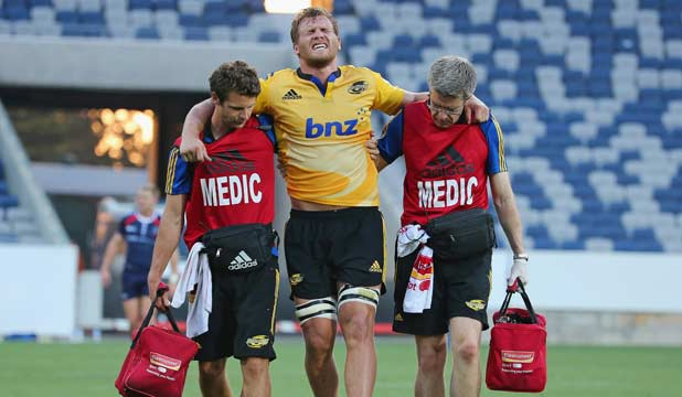 HOBBLED: Hurricanes loosie Brad Shields grimaces as he is helped from the field with a potentially serious knee injury.