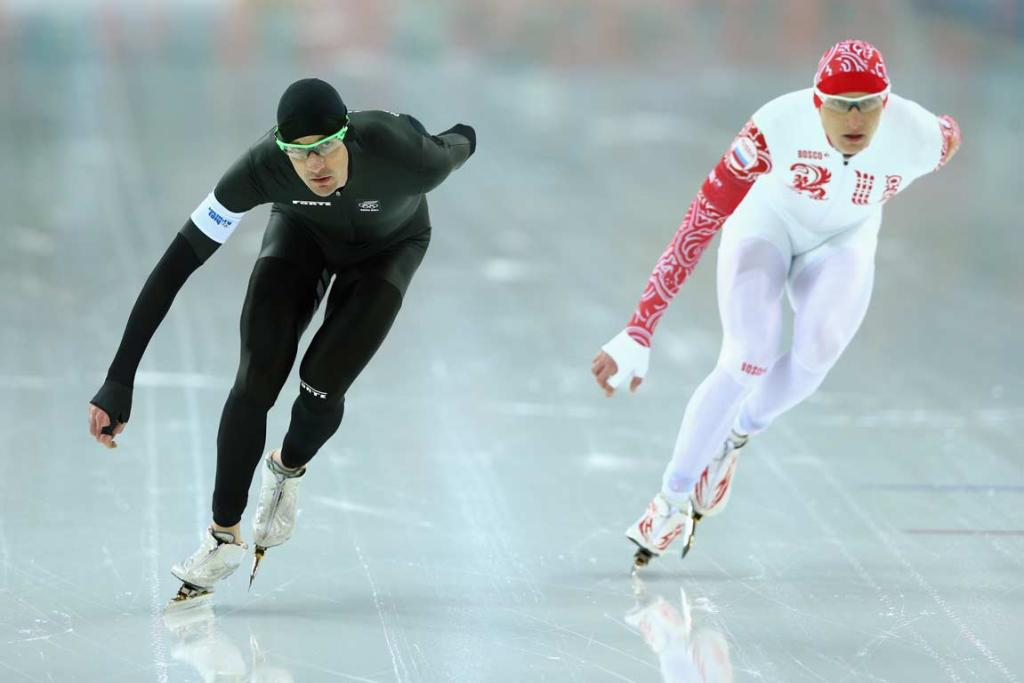 New Zealand's Shane Dobbin competes against Russia's Ivan Skobrev during the men's 5000m.