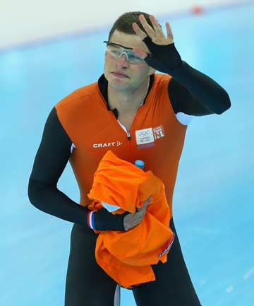 DOMINATION: Sven Kramer, who led a Dutch medal clean-sweep in the men's 5000m speed skating in an Olympic record time, waves to the crowd at the Adler Arena.