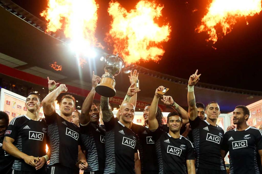 Burst of flames fire off behind the victorious New Zealand sevens team in Wellington.