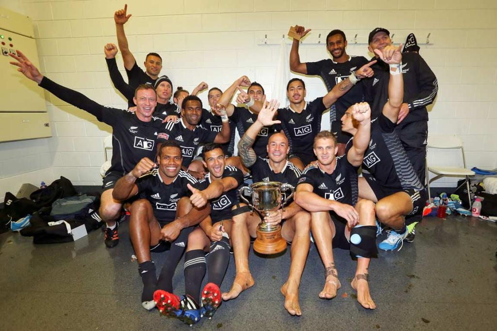 The New Zealand sevens team celebrate in the changing rooms after their Wellington Sevens final victory over South Africa.