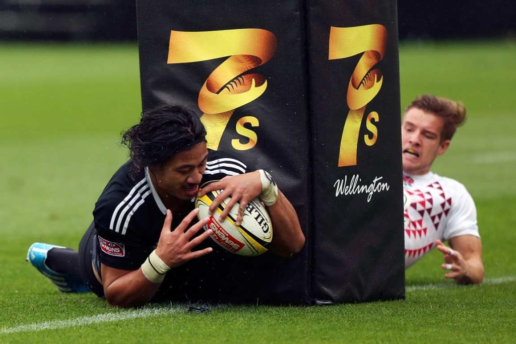New Zealand's Ben Lam crosses next to the posts during the semifinal against England.