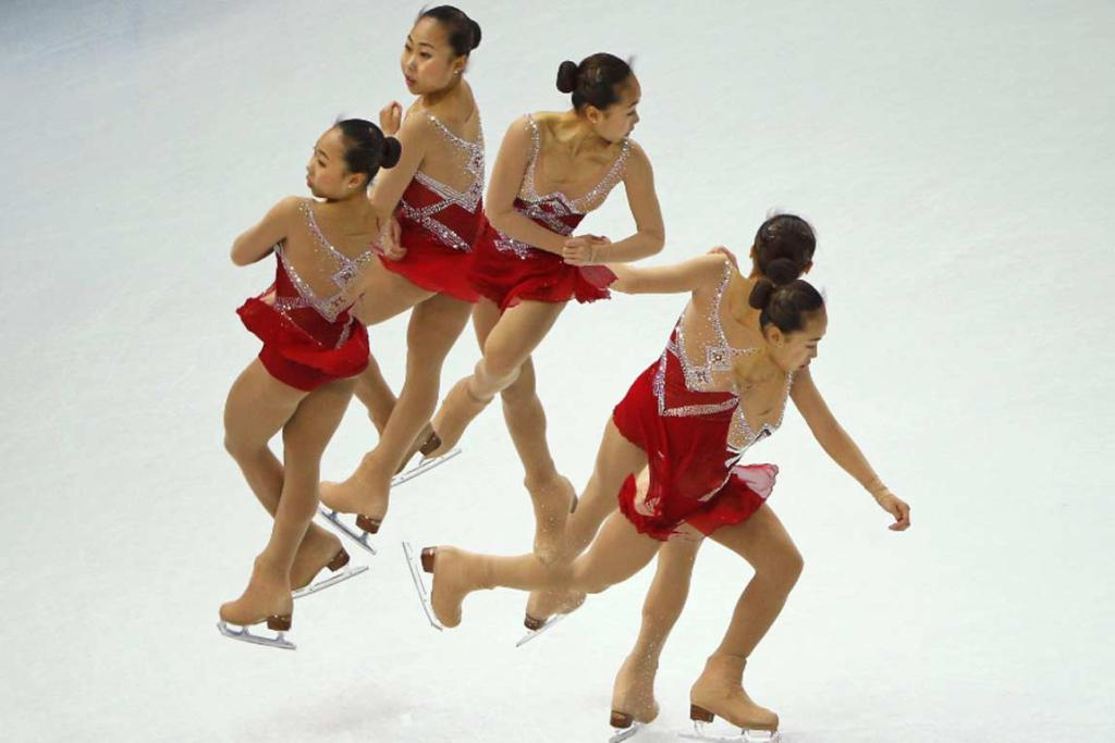 China's Zhang Kexin competes during the figure skating team ladies short program.