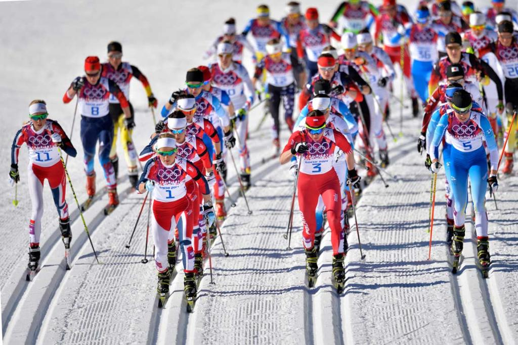 The field in the women's skiathlon, won by Norway's Marit Bjoergen, head away from the start.