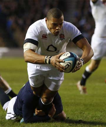 CENTRE OF ATTENTION: Centre Luther Burrell reaches out to score in England's 20-0 victory over Scotland at Murrayfield.