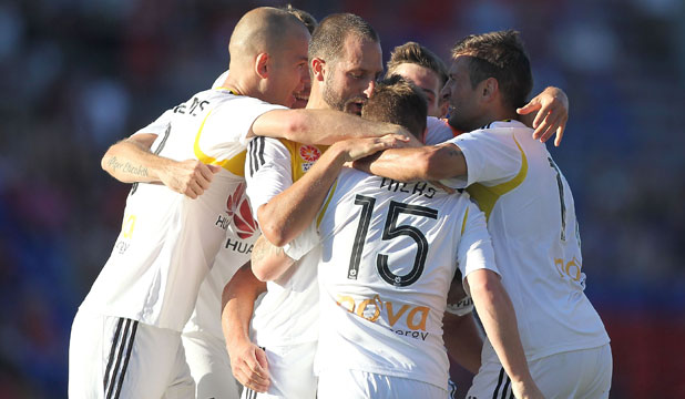 WHAT A BELTER: Phoenix substitute Jason Hicks is mobbed by his teammates after his brilliant individual goal took the Phoenix past the Jets in Newcastle.