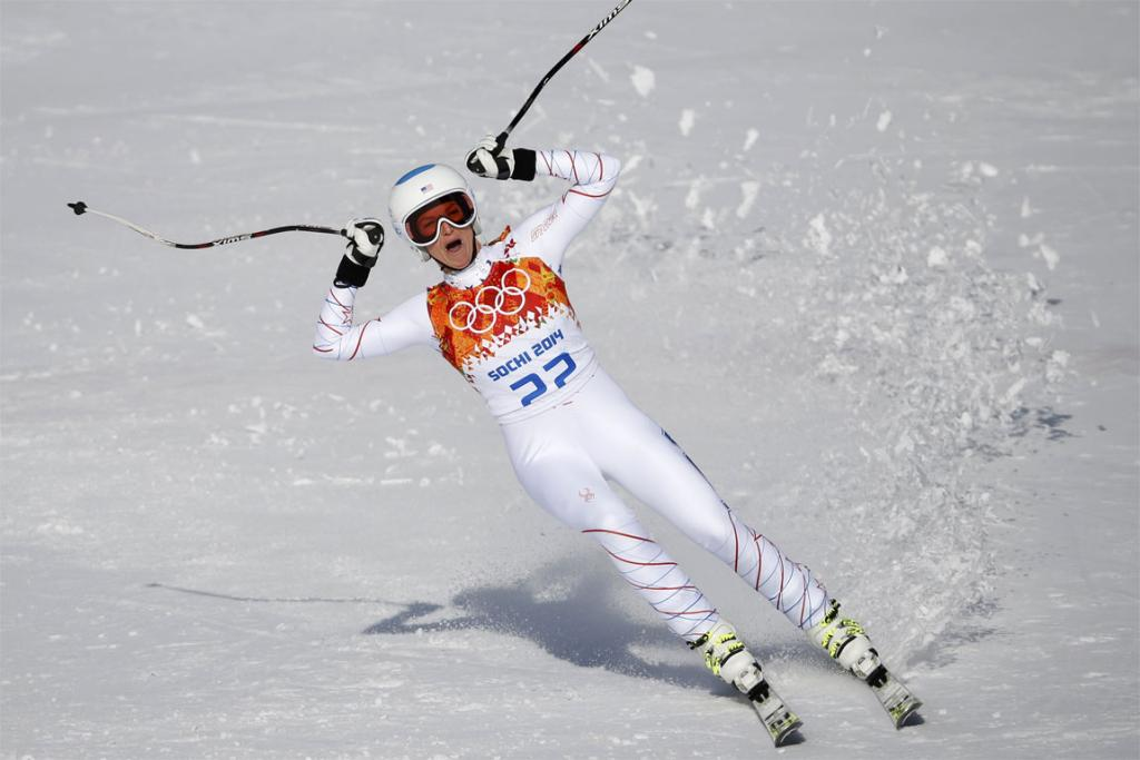 Julia Mancuso of the USA celebrates in the finish area after competing during the downhill run of the women's alpine skiing super combined event.