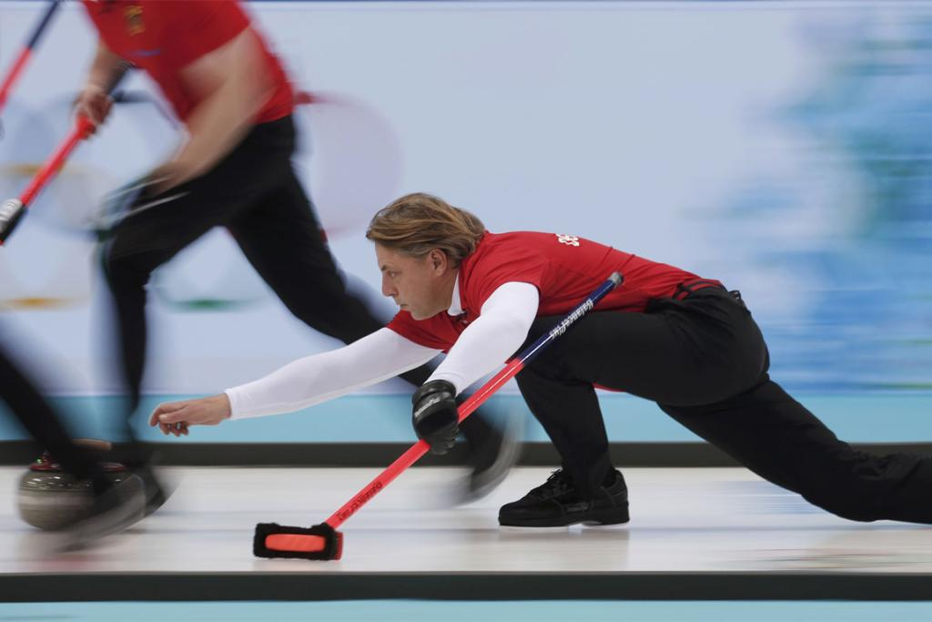 Germany's skip John Jahr delivers a stone during their men's curling round robin game against Canada.