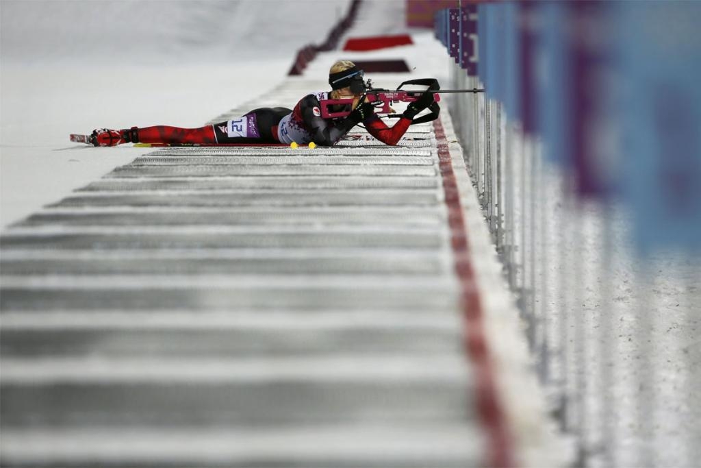 Canada's Zina Kocher shoots during the women's biathlon 7.5km sprint event.