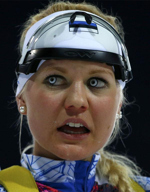 Estonia's Grete Gaim reacts after crossing the finish line during the women's biathlon 7.5km sprint event.