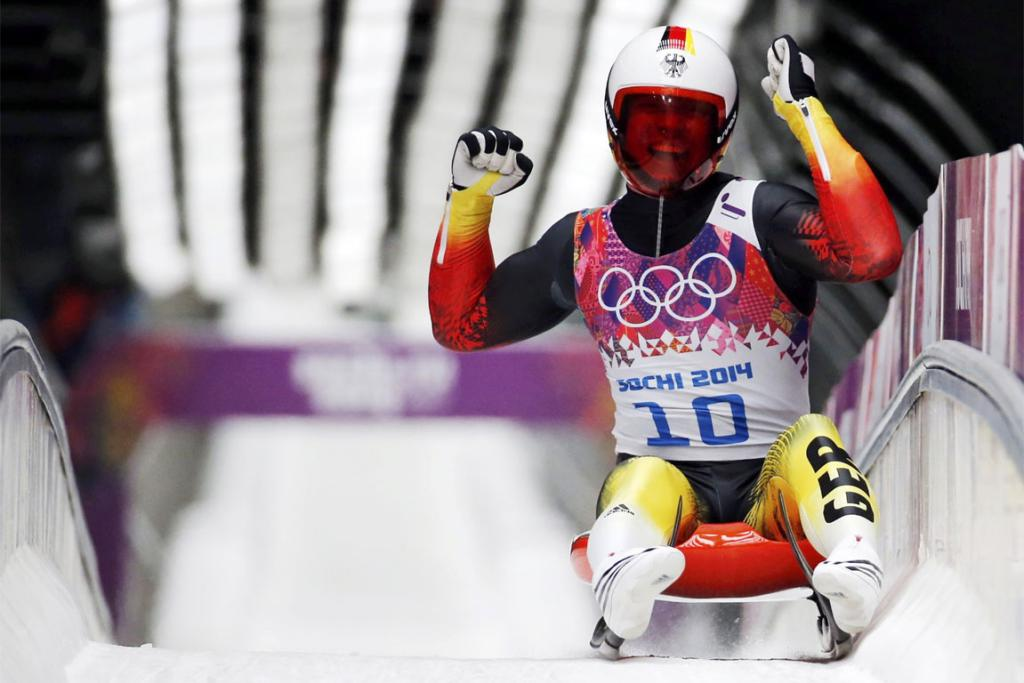 Winner Germany's Felix Loch celebrates after completing his final run in the men's singles luge competition.