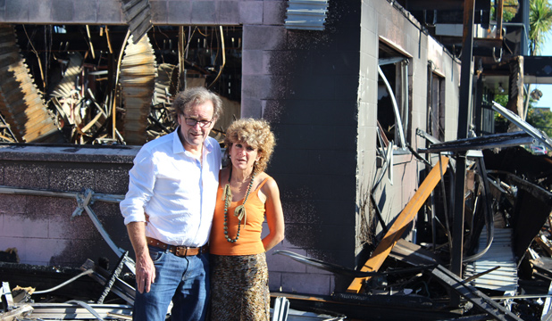 DEVASTATING LOSS: CC Interiors owners Mark and Elizabeth Wilkinson stand before their furniture warehouse and showroom which was destroyed in a fire.
