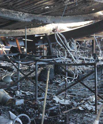 CHARRED REMAINS: The couple say their burned-out showroom was ''the most magnificent in the southern hemisphere''.