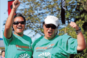 SATISFACTION: Leesa Curtis, left, and Aroha Gilling celebrate as they cross the finish line.