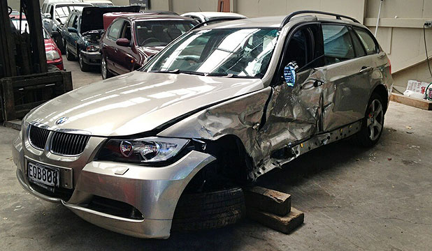 BENT AND BROKEN: Kristian Slack's Three Series BMW station wagon was written off after being T-boned by a police car in Stratford.