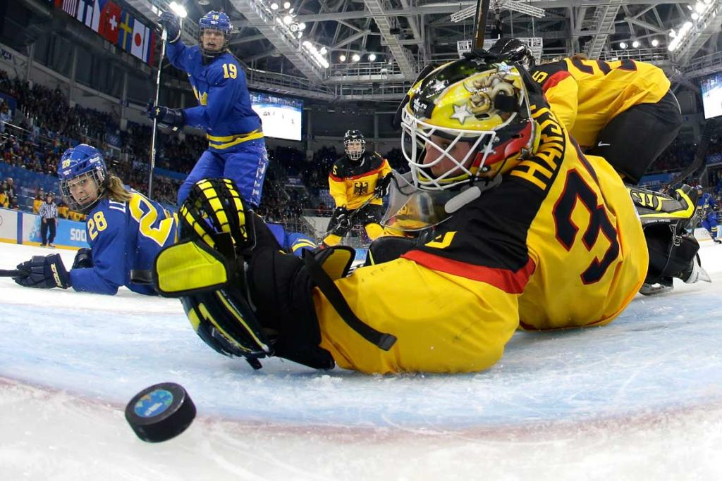 German netminder Jennifer Harss reaches back but can't prevent Sweden from scoring.