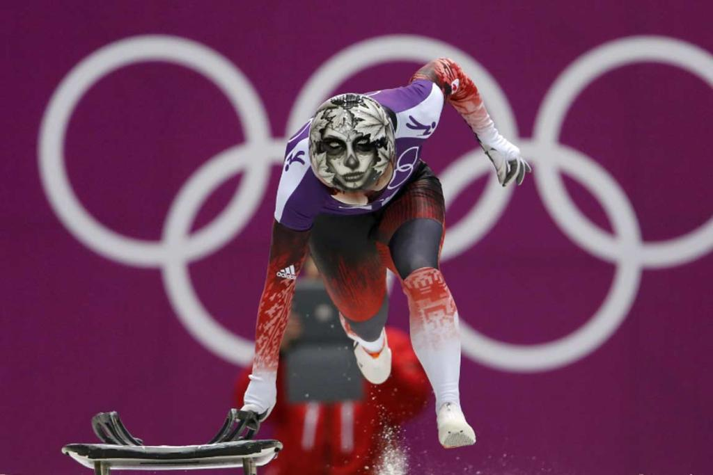 Canada's Sarah Reid shows off her spooky helmet during a skeleton training run.