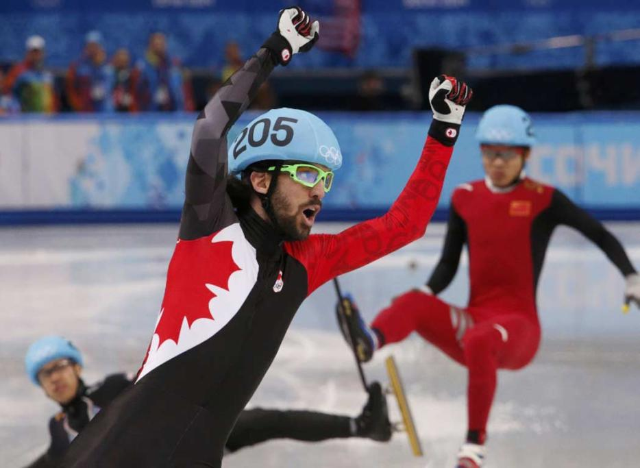 Charles Hamelin of Canada celebrates his victory in the men's 1500m short track speed skating final.