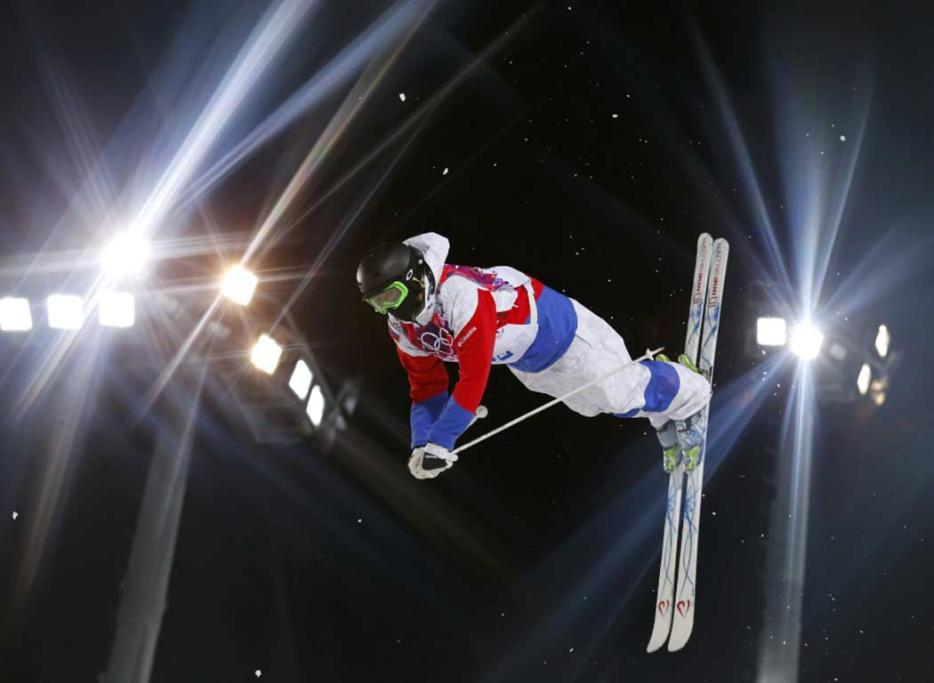 Russia's Aleksey Pavlenko performs a jump during the men's freestyle skiing moguls qualification round.