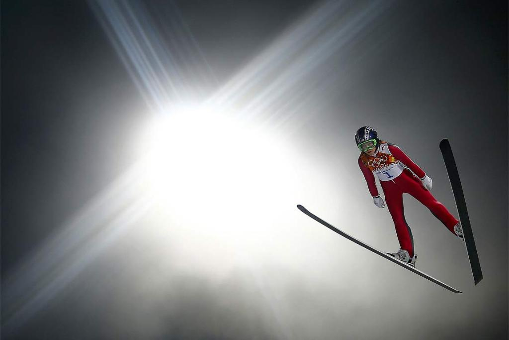 Sarah Hendrickson of the US soars through the air at the women's ski jumping.