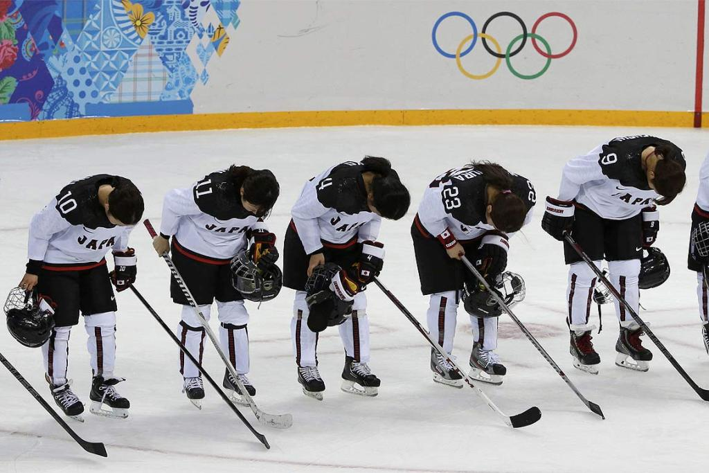 Members of Japan's women's ice hockey team bow to the crowd after their loss to Russia.