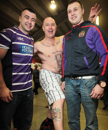 BROTHERS IN ARMS: English fans Gary, John and Paul Shaw show their Wigan Warriors colours with pride. The touring side played New Zealand's Vodafone Warriors at Waikato Stadium last night.