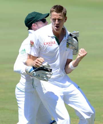 PINNING THEM DOWN: South African quick Morne Morkel celebrates the wicket of Australian opener Chris Rogers on the opening day of the first test at Centurion.