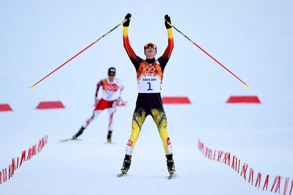 Germany's Eric Frenzel crosses the line ahead of Japan's Akito Watabe to win the men's nordic combined normal hill event.