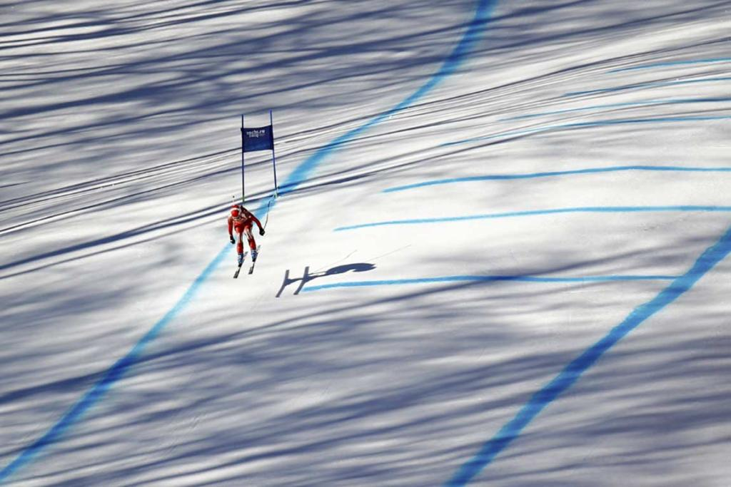 Switzerland's Dominique Gisin speeds down the course on her way to tying for gold in the women's alpine skiing downhill.