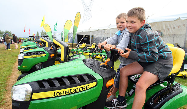 DEALS ON WHEELS: Ben Fitchett, 6, and his brother, Ryan, 8, check the John Deere mowers on display at the Southern Field Days.