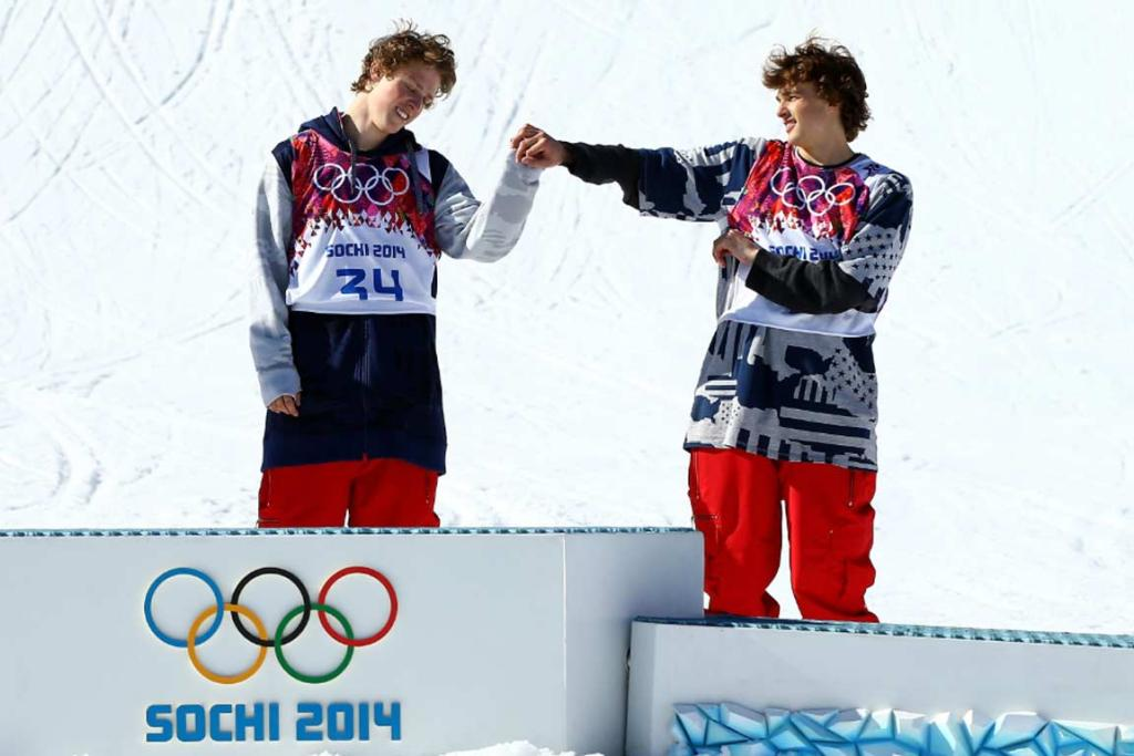Gold medalist Joss Christensen (left) bumps knuckles with bronze medalist Nicholas Goepper after the USA swept the men's ski slopestyle podium.