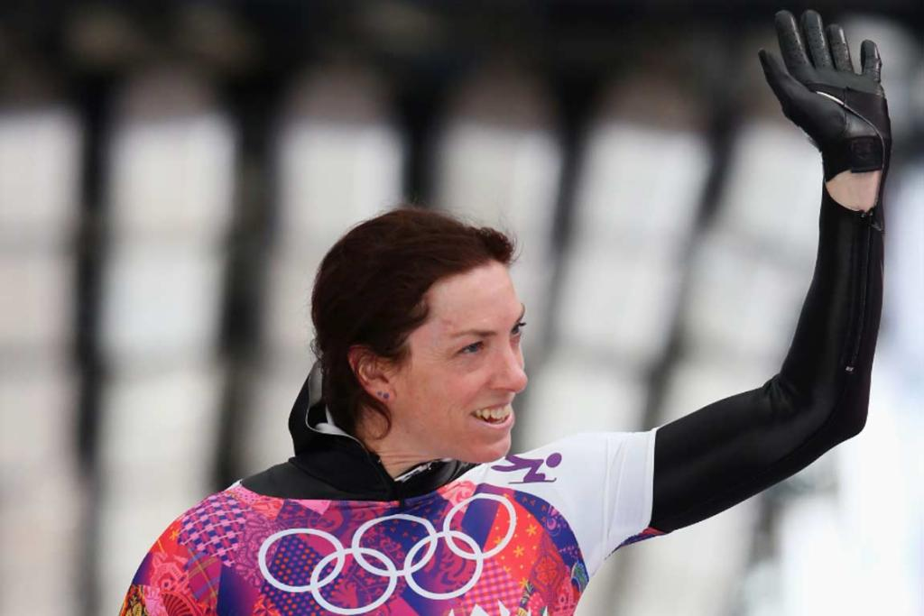 Katharine Eustace waves to the crowd after one of her two skeleton heats runs.