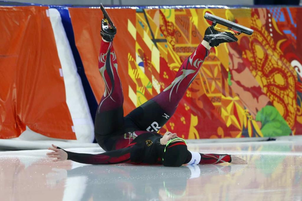 Germany's Monique Angermueller crashes out of the women's 1000m speed skating semifinals.