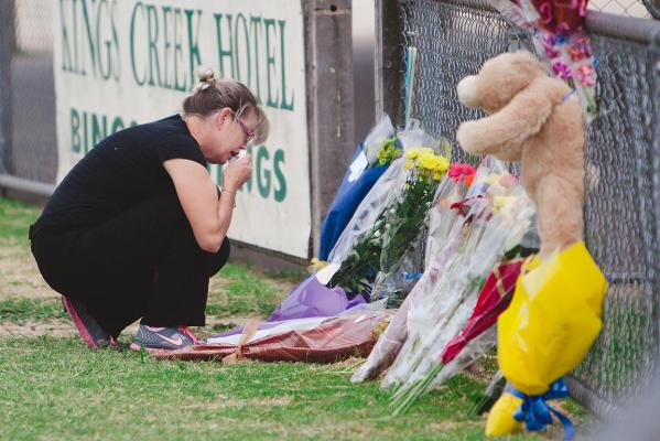 Community members mourn at Tyabb oval following the murder of 11-year-old Luke Batty.