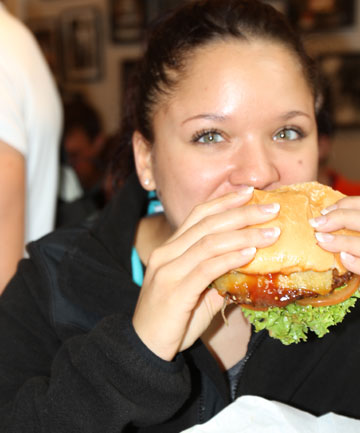 Rhoniesha Seubert, visiting from the United States, munches into a world-famous Fergburger.