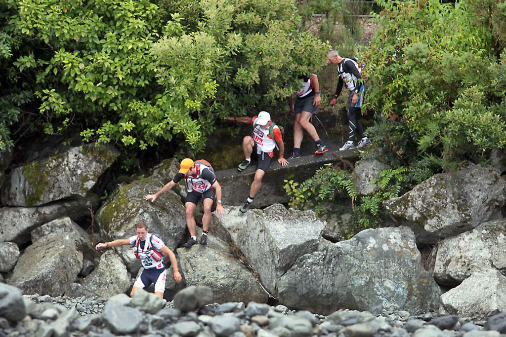 AIMING FOR DECEPTION: Athletes making their way toward Deception River at the bridge.