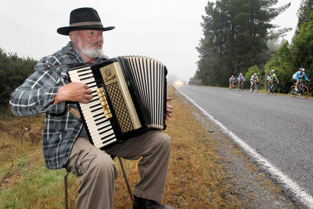 LIGHT RELIEF: John Acker on the accordian entertains Coast to Coast competitors near Kumara.