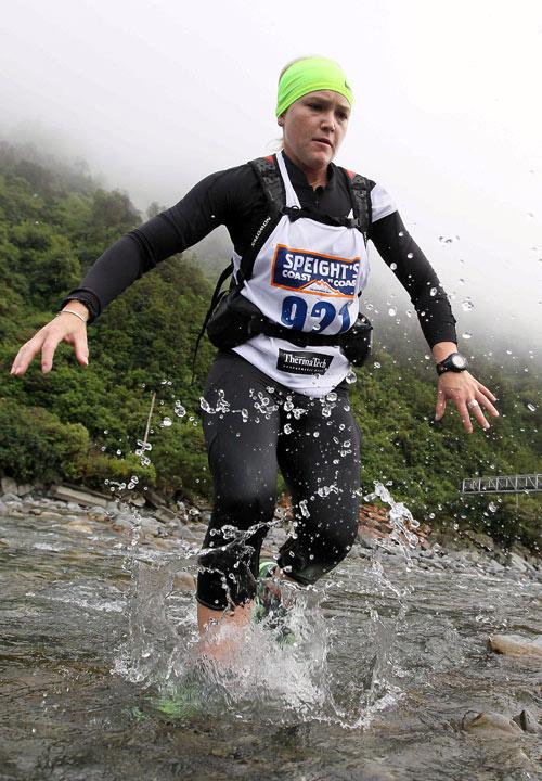 HEADING FOR HIGH GROUND: Kristin McNaughton entering Deception River to start the mountain run.