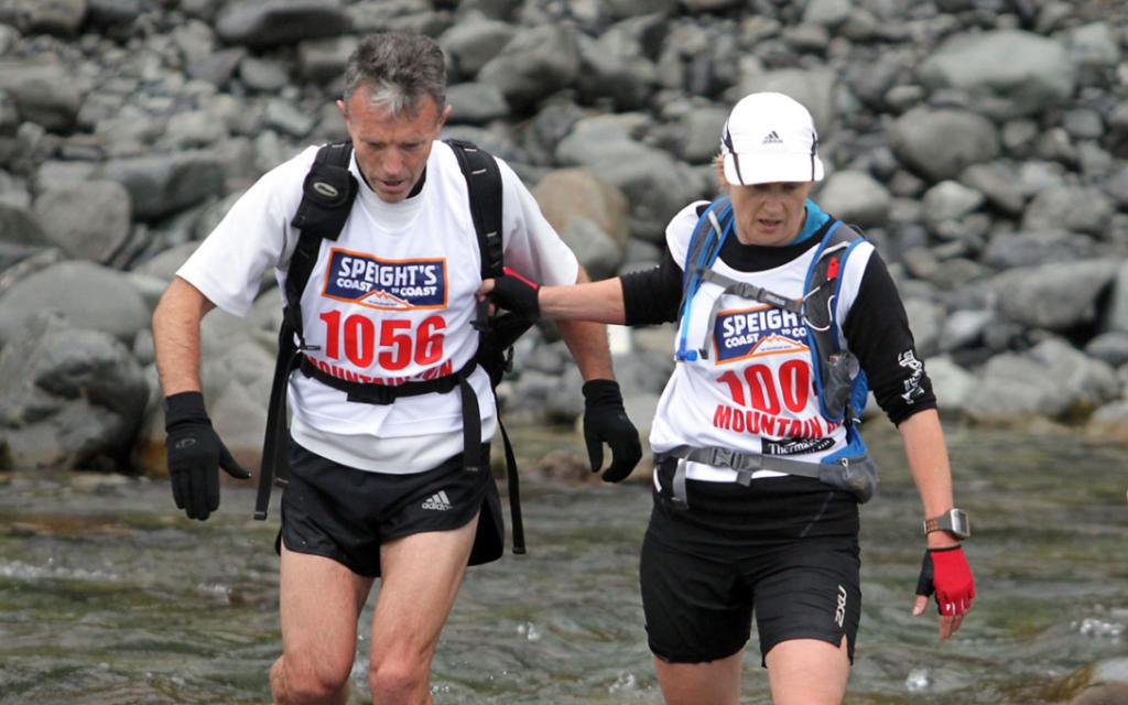HELPING HAND: Competitors help each other out at the start of the mountain run.