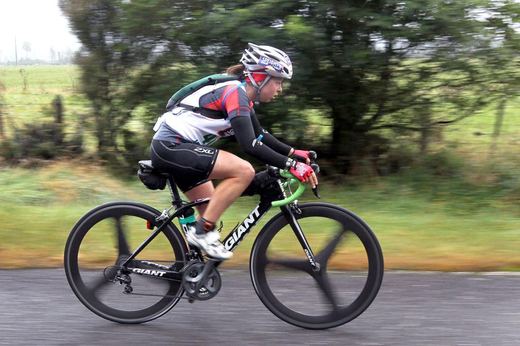 POWERING: Fiona Dowling (individual) heading towards the Deception Bridge from Kumara.
